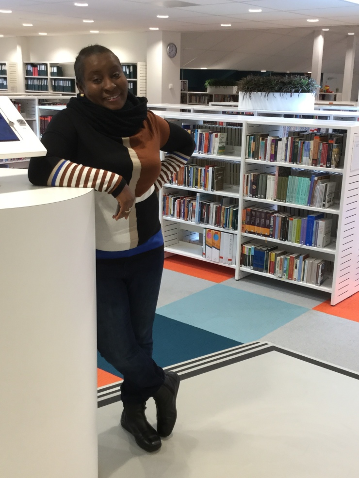 Emi Alawode at the library